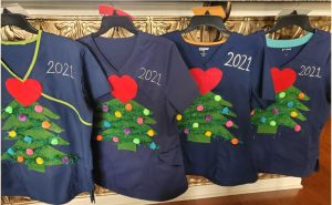 """An image of hospital scrubs decorated for Little River Medical Center's """"Caring at Heart"""" event."""